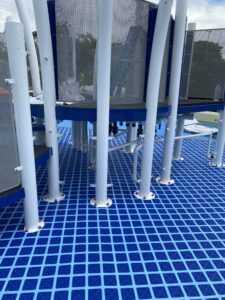 Pole image of Combilock over Combiflex - safety attenuation achieved in wet playground